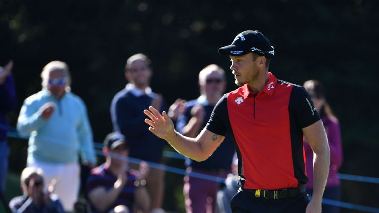 Danny Willett battled his way to a three-shot victory at Wentworth