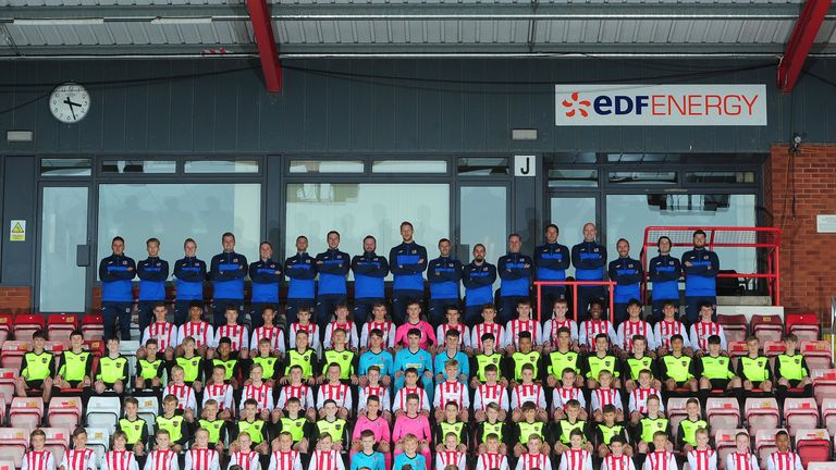 The players and staff at Exeter City's academy line up for a group photo