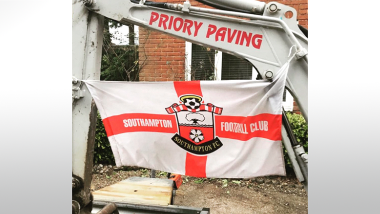 "Bournemouth fan Crouch discovered his client had ""decorated"" his digger. Credit: Twitter/AntonCrouch"