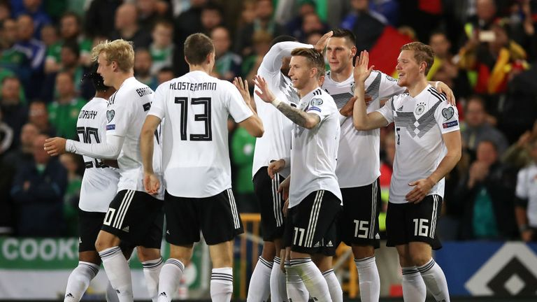 Marcel Halstenberg of Germany celebrates with teammates after scoring his team's first goal
