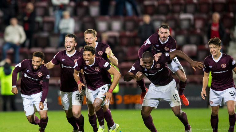 Hearts players celebrate after winning the penalty shootout