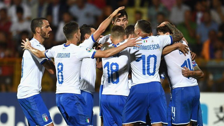 Andrea Belotti celebrates with team-mates after scoring for Italy