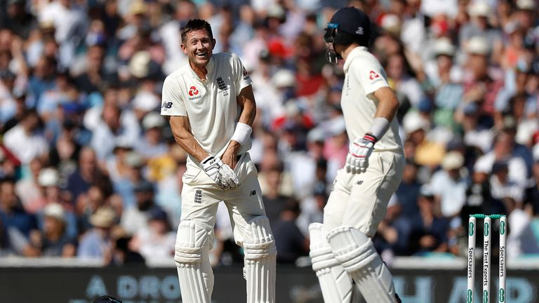 Denly laughs after being hit in the groin by a delivery