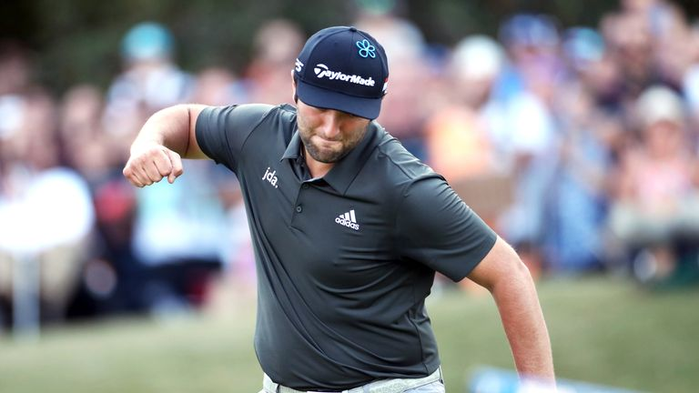 Jon Rahm celebrates after making a vital par at the 18th during the third round at Wentworth