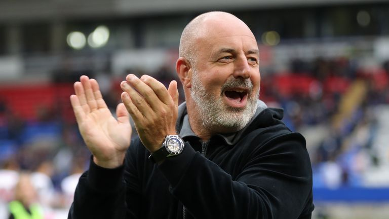 Bolton manager Keith Hill applauds fans before the game