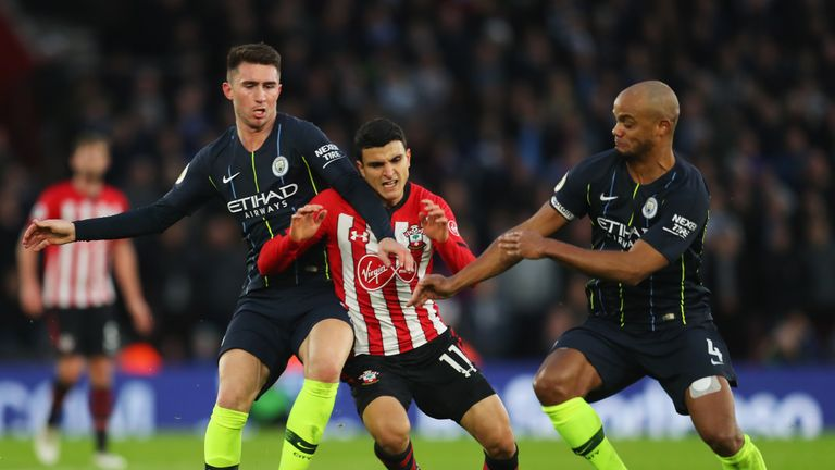Vincent Kompany (right) playing alongside Laporte (left) for City last season