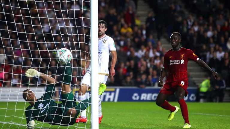 A goalkeeping howler from MK Dons' Stuart Moore saw Liverpool take the lead