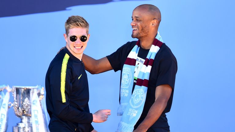Vincent Kompany and Kevin De Bruyne celebrate City's domestic treble triumph last season