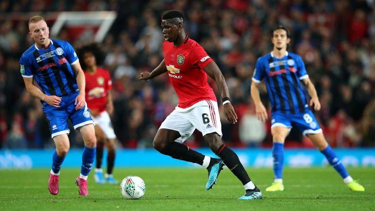 Injured Paul Pogba was unable to take a penalty as United beat Rochdale in a shoot-out