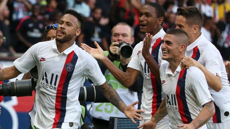Neymar celebrates after scoring a stoppage-time winner for PSG against Strasbourg
