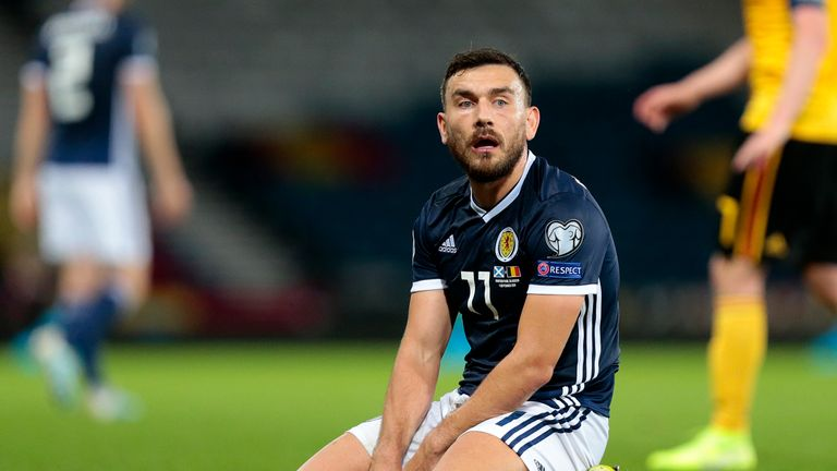 Robert Snodgrass looks dejected during the defeat by Belgium