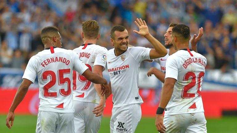 Joan Jordan celebrates the goal that sent Sevilla to the top of La Liga