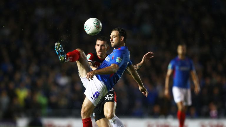 Portsmouth's Brett Pitman challenges for the ball with Southampton's Pierre-Emile Hojbjerg
