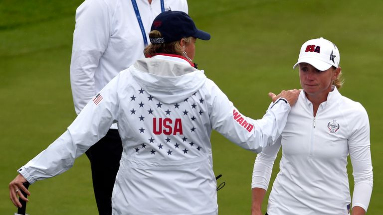 Lewis was consoled by captain Juli Inkster as it became clear she would be unable to play this week