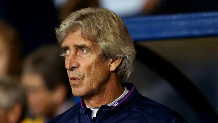Manuel Pellegrini endured a miserable night at the Kassam Stadium