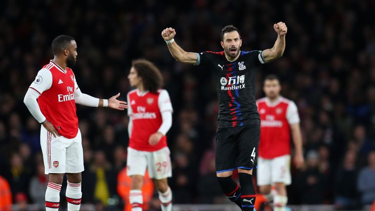 Luka Milivojevic celebrates at the Emirates