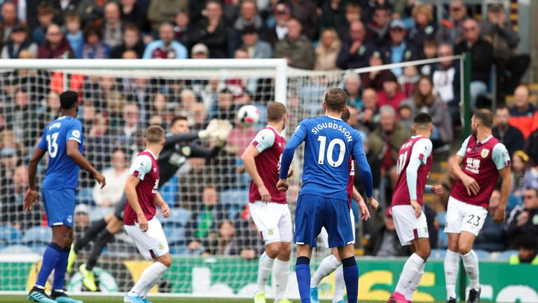 Gylfi Sigurdsson sees his early free-kick tipped around the post by Nick Pope