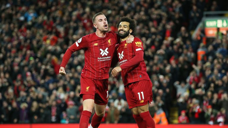 Goalscorers Jordan Henderson and Mohamed Salah celebrate Liverpool's second goal of the game