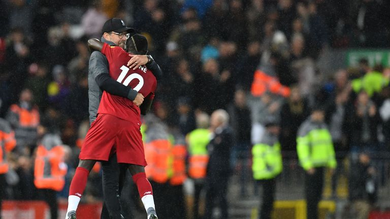 Klopp hugs Sadio Mane after the crucial victory