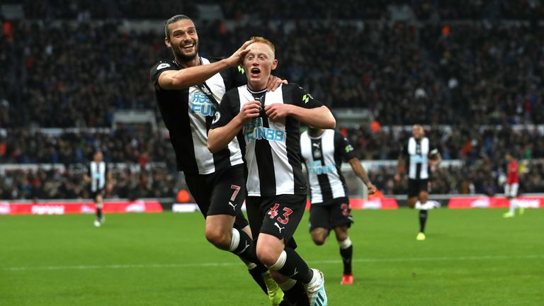 Matty Longstaff celebrates his winner against Manchester United with team-mate Andy Carroll