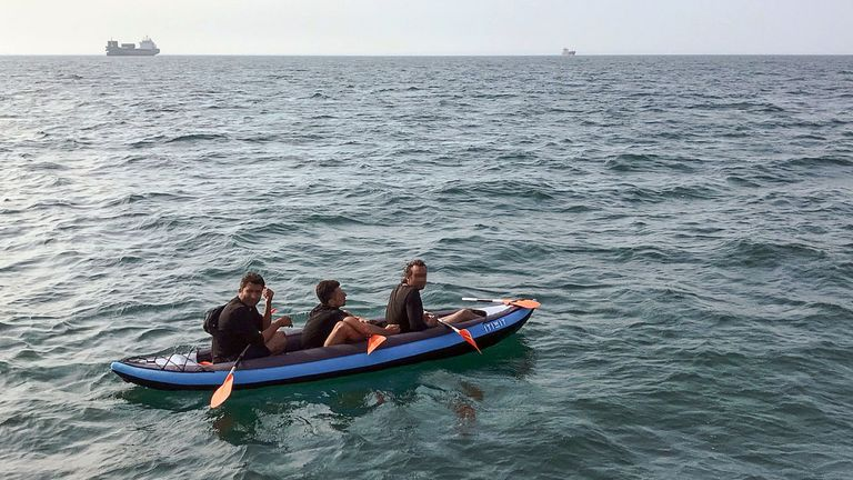 Some migrants attempt to reach the English shoreline in inflatable canoes - these men were rescued by lifeguards in August 2018