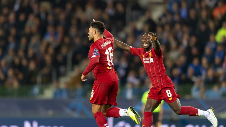 Oxlade-Chamberlain wheels away in delight and is congratulated by Naby Keita