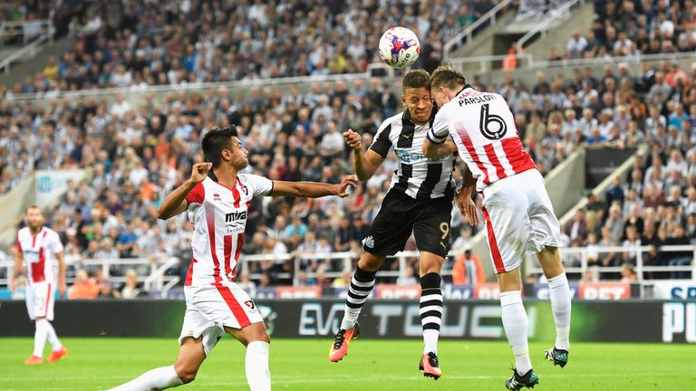 Parslow clashes heads with Newcastle's Dwight Gayle during his time at Cheltenham