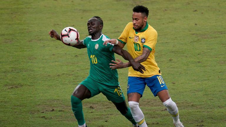 Liverpool's Sadio Mane tussles with Neymar