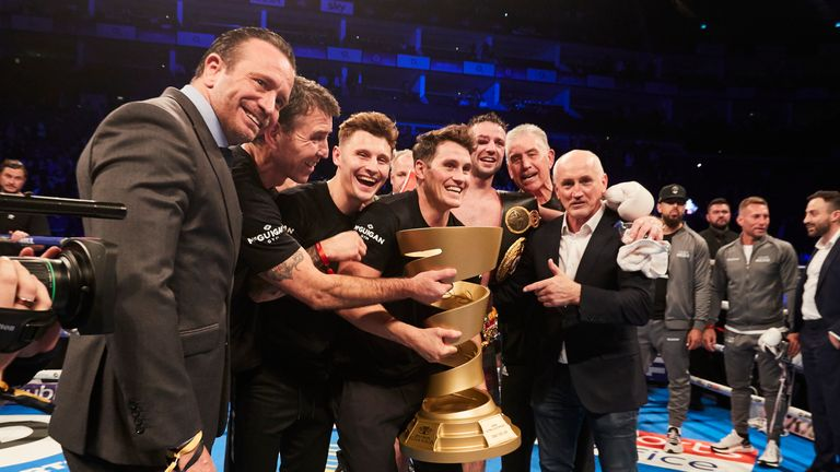 McGuigan and Taylor's team celebrate a career-defining win