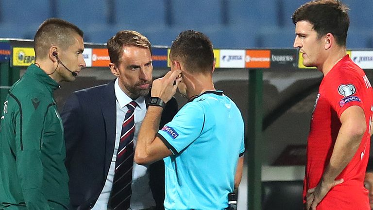 Gareth Southgate speaks to the referee after racist chants were heard during Bulgaria vs England