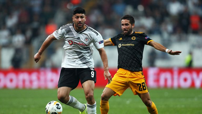 Guven Yalcın of Besiktas battles for possession with Joao Moutinho
