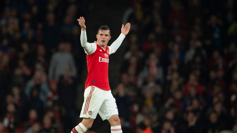 Xhaka reacts to jeers from the Arsenal supporters as he leaves the field