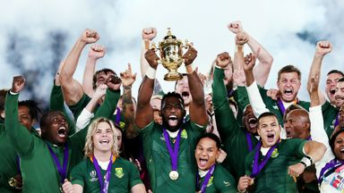 Siya Kolisi of South Africa lifts the Web Ellis cup following his team's victory against England