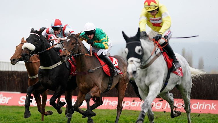 Barry Geraghty riding Defi Du Seuil (green and gold) to victory