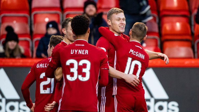 Aberdeen's Sam Cosgrove celebrates with his team-mates after opening the scoring against St Mirren