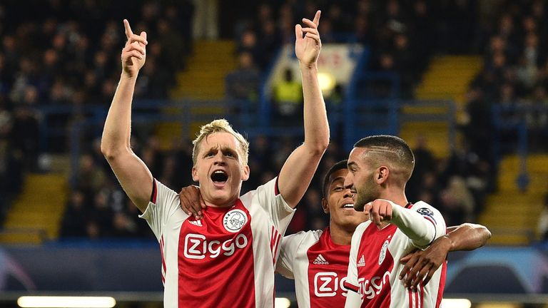 Donny Van de Beek (left) celebrates with Ajax team-mates after scoring their fourth goal against Chelsea