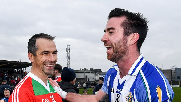 Michael Darragh Macauley of Ballyboden St Endas and Dessie Dolan of Garrycastle embrace after the game