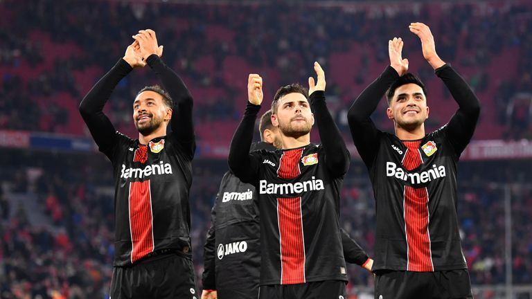 Bayer Leverkusen celebrate with their fans after beating Bayern Munich