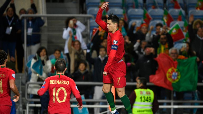 Cristiano Ronaldo celebrates after he scores the first goal against Lithuania
