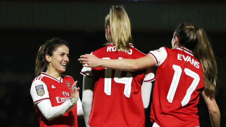 Danielle van de Donk celebrates with team-mates Jill Roord and Lisa Evans after scoring Arsenal's sixth goal at home to Slavia Prague