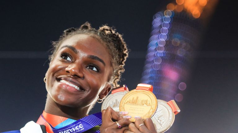 Dina Asher-Smith poses with the medals from this year's IAAF Athletics World Championships