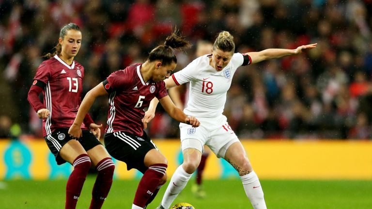 England's White and Lena Oberdorf of Germany battle for possession