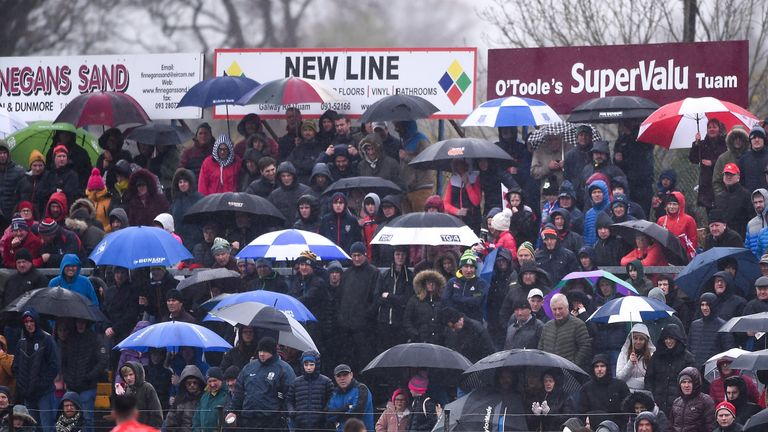 There through it all! Spectators brave the elements to watch the Galway county final in Tuam