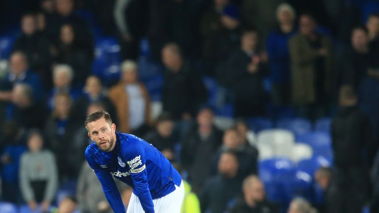 Gylfi Sigurdsson slumps to his haunches after the loss to Norwich