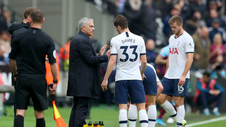 Mourinho speaks to Ben Davies during a break in play at the London Stadium