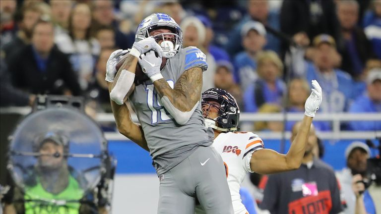 Lions receiver Kenny Golladay rises to make the catch ahead of Bears cornerback Kyle Fuller
