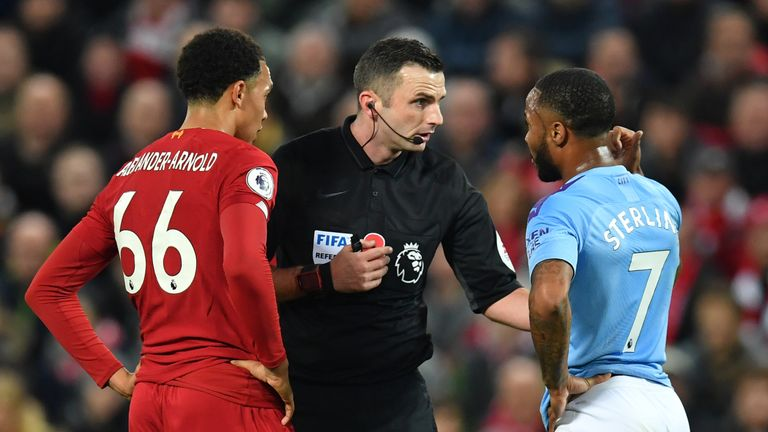 Referee Michael Oliver chats with Alexander-Arnold and City's Raheem Sterling