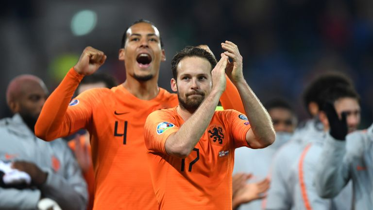 The Netherlands celebrate their qualification after drawing against Northern Ireland