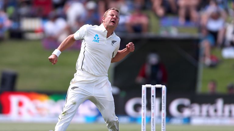 New Zealand's Neil Wagner celebrates after taking the wicket of England's captain Joe Root