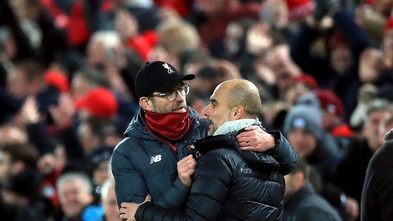 Liverpool manager Jurgen Klopp embraces Manchester City boss Pep Guardiola